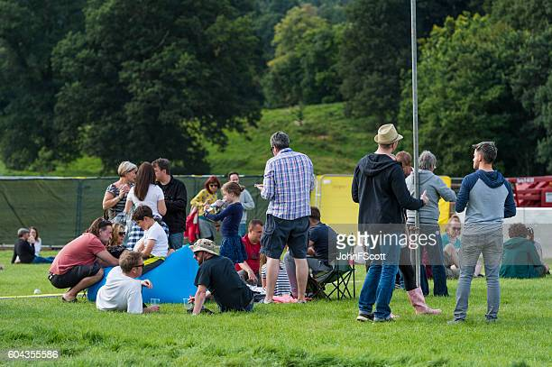 Festival goers in the main arena at a music festival