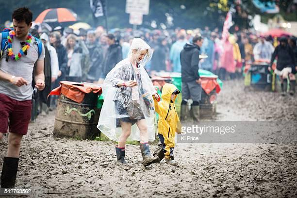 Festival goers in the rain on Day 1 of the Glastonbury Festival 2016 at Worthy Farm Pilton on June 24 2016 in Glastonbury England
