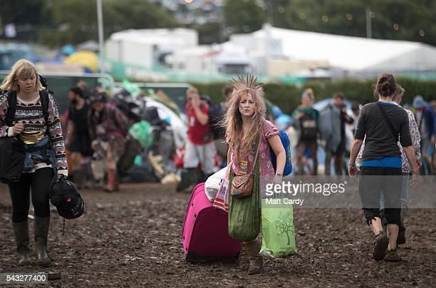 Festival goers leave the Glastonbury Festival 2016 at Worthy Farm Pilton on June 26 2016 near Glastonbury England The Festival which Michael Eavis...