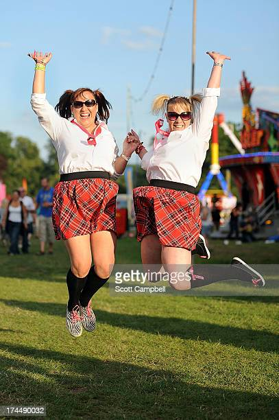 Festival goers Marion Lewis and Louise Murray from Dundee pose in fancy dress during Rewind 80s Festival 2013 at Scone Palace on July 26 2013 in...