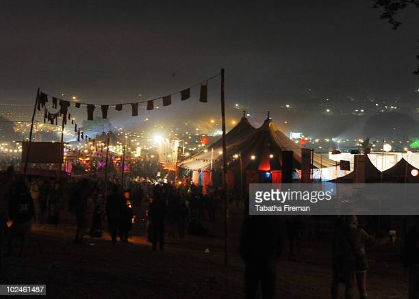 Festival goers party through the night and into the early hours of the final day of Glastonbury Festival at Worthy Farm on June 27, 2010 in...