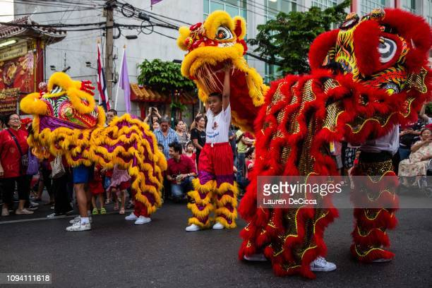 Festival goers perform a dragon dance at the Chinese lunar new year on Yarowat Road in Chinatown on February 5 2019 in Bangkok Thailand