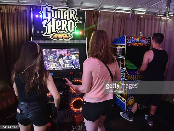 Festival goers play Guitar Hero in the VIP Lounge during the Firefly Music Festival on June 19 2016 in Dover Delaware