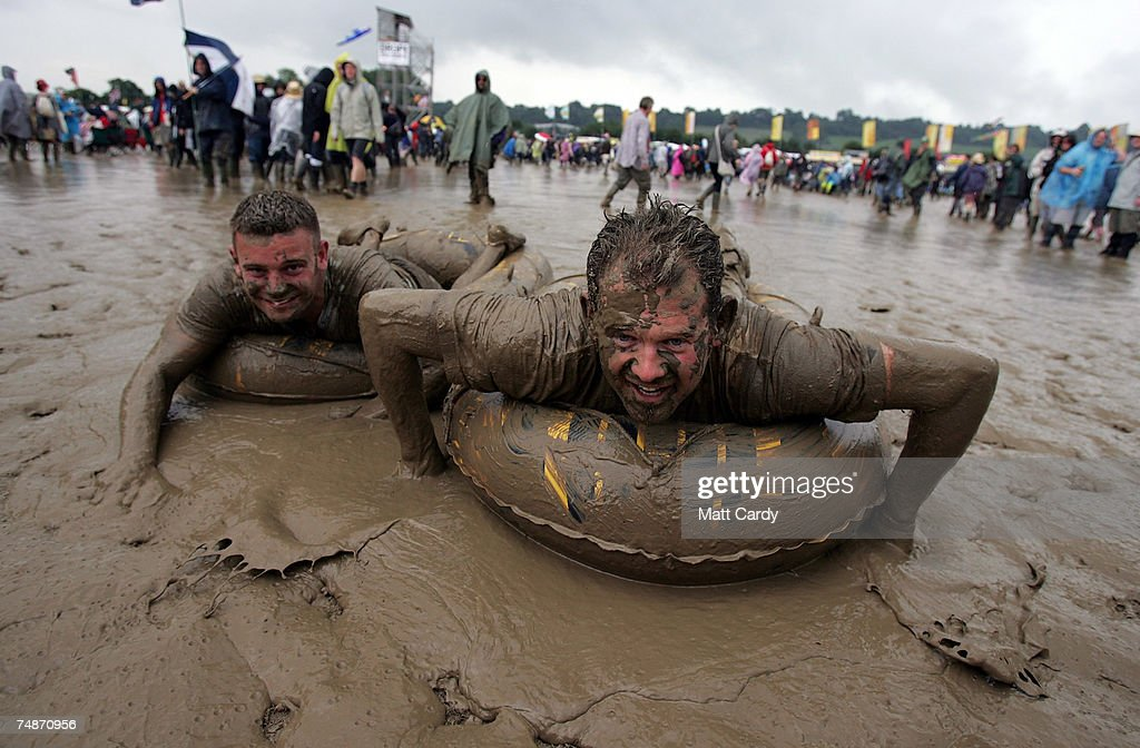Festival goers play in the mud near the other stage at Worthy Farm, Pilton near Glastonbury, on June 23, 2007 in Somerset, England. The festival, that was started by dairy farmer Michael Eavis in 1970, has grown into the largest music festival in Europe. This year's festival is the biggest yet and will have headline acts including The Who, The Artic Monkeys and The Killers.