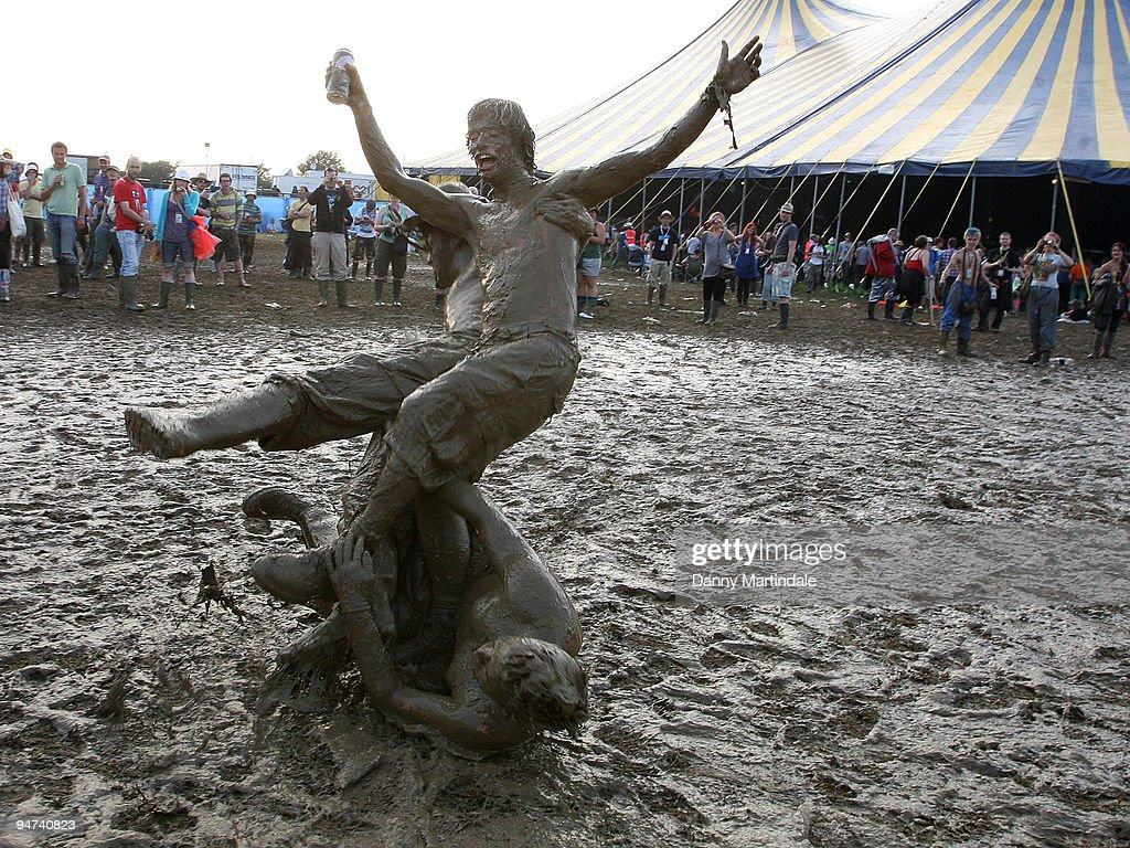 Festival goers play in the mud on day two of the Glastonbury Festival at Worthy Farm on June 26, 2009 in Glastonbury, England.
