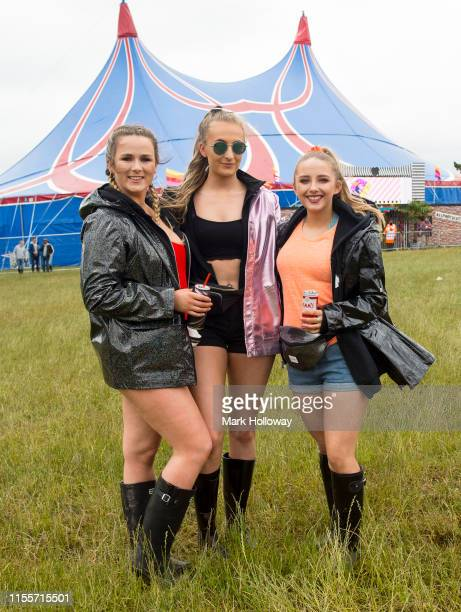 Festival goers pose for a photograph at Isle of Wight Festival 2019 at Seaclose Park on June 13 2019 in Newport Isle of Wight