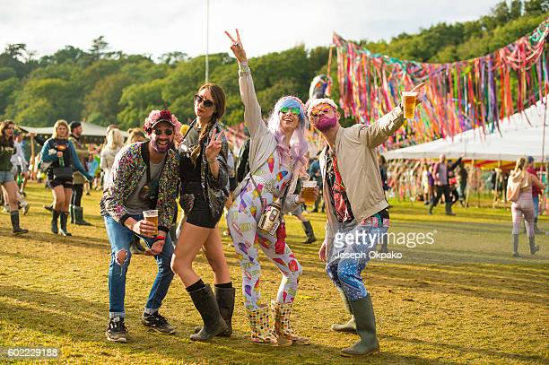 Festival goers pose in their 'The Future' themed fancy dress on Day 3 of Bestival at Robin Hill Country Park on September 10 2016 in Newport Isle of...