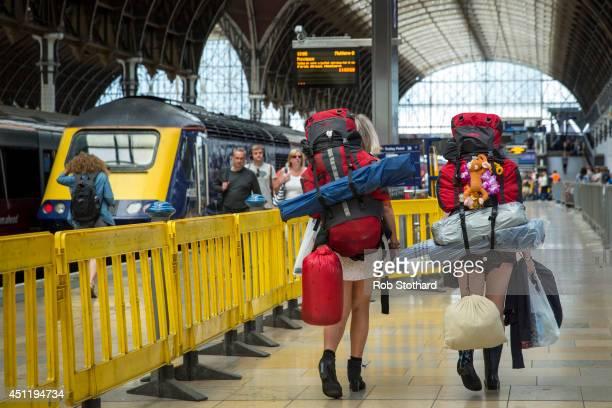 Festival goers prepare to board trains at Paddington station to travel to Castle Cary station for the first day of the 2014 Glastonbury Festival on...