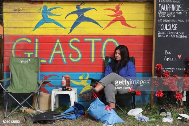 Festival goers prepare to leave the Glastonbury Festival site at Worthy Farm in Pilton on June 26 2017 near Glastonbury England Glastonbury Festival...