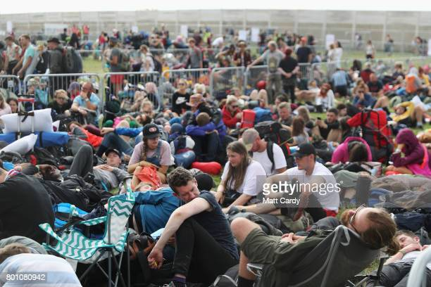 Festival goers prepare to leave the Glastonbury Festival site at Worthy Farm in Pilton on June 26 2017 near Glastonbury England Glastonbury Festival...