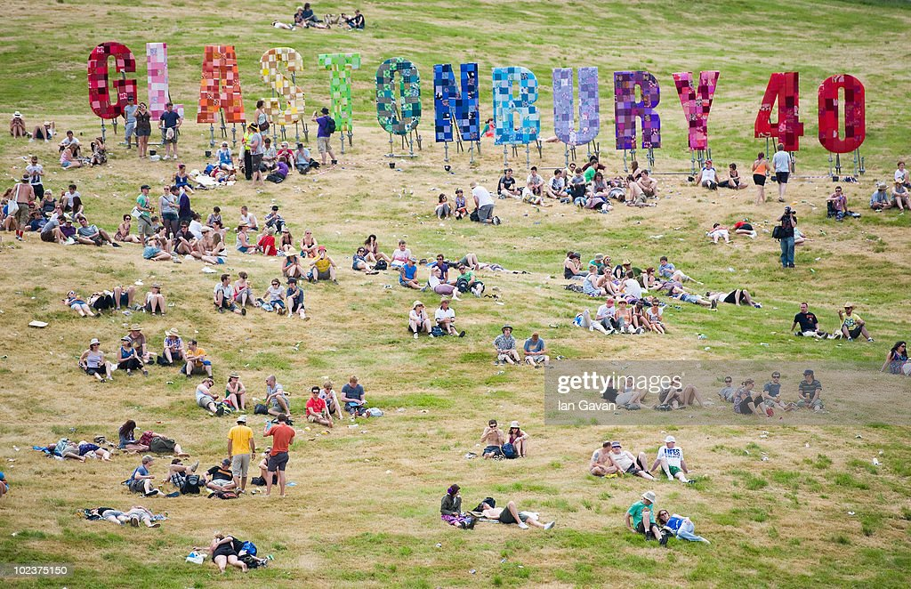 Festival Goers relax in a field on Day 1 of the Glastonbury Festival on June 24, 2010 in Glastonbury, England. This year sees the 40th anniversary of the festival which was started by a dairy farmer, Michael Evis in 1970 in 1970 and has grown into the largest music festival in Europe.