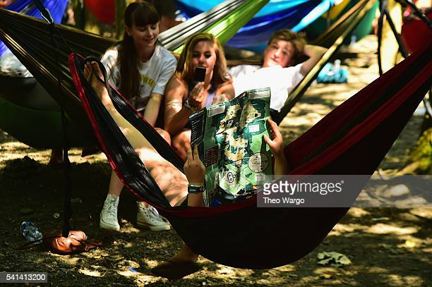 Festival goers relax in hammocks while checking out the Firefly site map during the Firefly Music Festival on June 19, 2016 in Dover, Delaware.