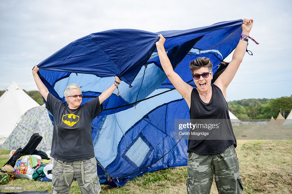 Festival goers set up in the campsite on the first day of Camp Bestival at Lulworth Castle on July 31, 2014 in Wareham, United Kingdom.