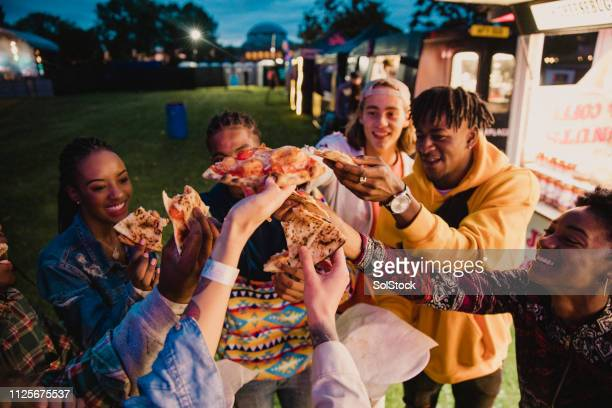 Festival Goers Sharing Pizza