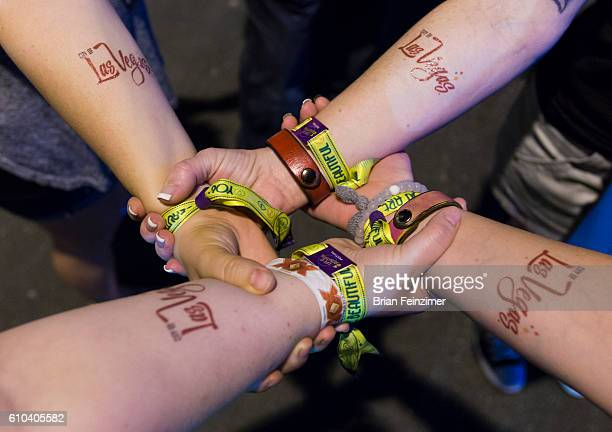 Festival goers showoff their Life is Beautiful wristbands along with City of Las Vegas temporary tattoos during the 2016 Life is Beautiful festival...