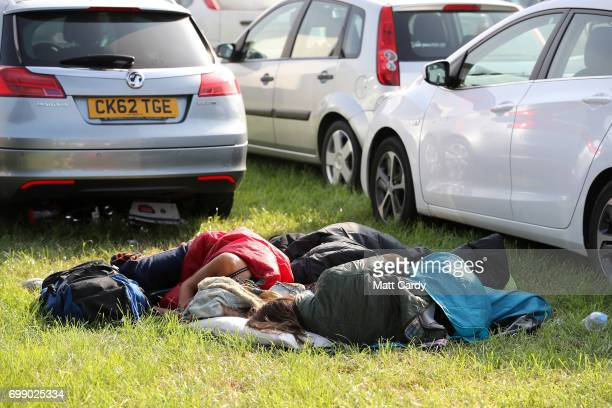 Festival goers sleep in the car park as gates open at the Glastonbury Festival amid heightened security at Worthy Farm in Pilton on June 21 2017 near...
