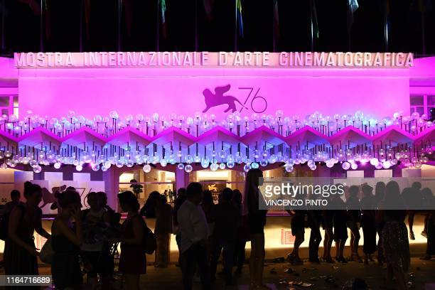 Festival goers stand outside the Festival's Palace on August 29 2019 after guests arrived for the screening of the film Ad Astra during the 76th...
