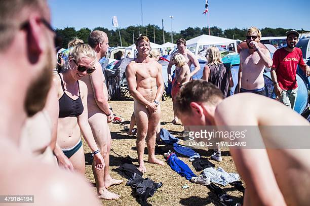 Festival goers take off their clothes during the Roskilde Festival 2015 in Roskilde southwest of Copenhagen on July 1 2015 This year's festival runs...
