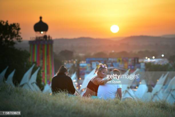 Festival goers take selfies at sunset during day two of Glastonbury Festival at Worthy Farm, Pilton on June 27, 2019 in Glastonbury, England. The...