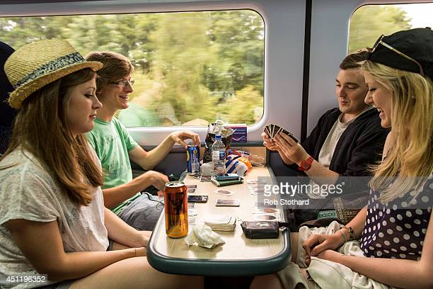 Festival goers travel by train from Paddington station to Castle Cary station for the first day of the 2014 Glastonbury Festival on June 25 2014 in...