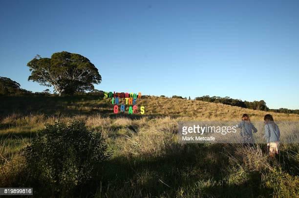 Festival goers walk towards a Splendour In The Grass sign during Splendour in the Grass 2017 on July 21 2017 in Byron Bay Australia