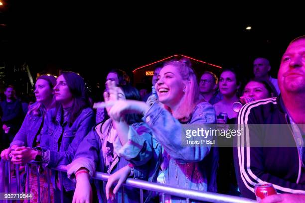 Festival goers watch Amy Shark perform onstage at Pandora during SXSW at Stubb's BarBQ on March 15 2018 in Austin Texas