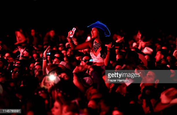 Festival goers watch Diplo perform onstage during the 2019 Stagecoach Festival at Empire Polo Field on April 28, 2019 in Indio, California.