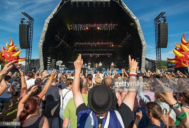 Festival goers watch Dreadzone perform on the main stage on the first day of The Wickerman festival on July 26, 2013 in Dundrennan, Scotland.