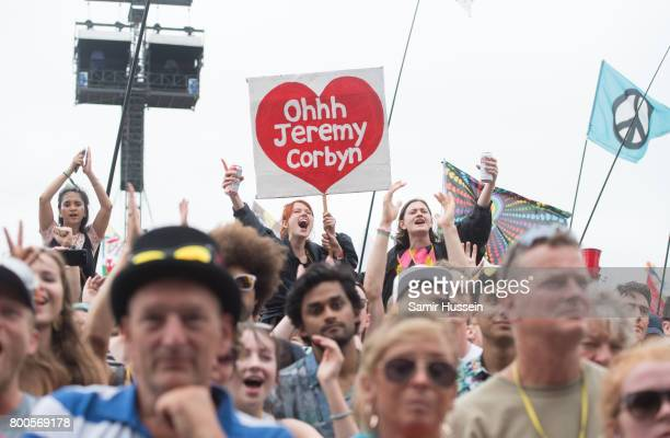 Festival goers watch Jeremy Corbyn on day 3 of the Glastonbury Festival 2017 at Worthy Farm Pilton on June 24 2017 in Glastonbury England