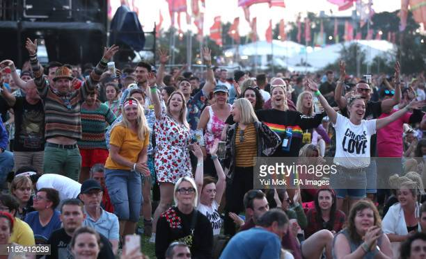 Festival goers watch the England World Cup match on a big screen at the Glastonbury Festival at Worthy Farm Pilton Somerset