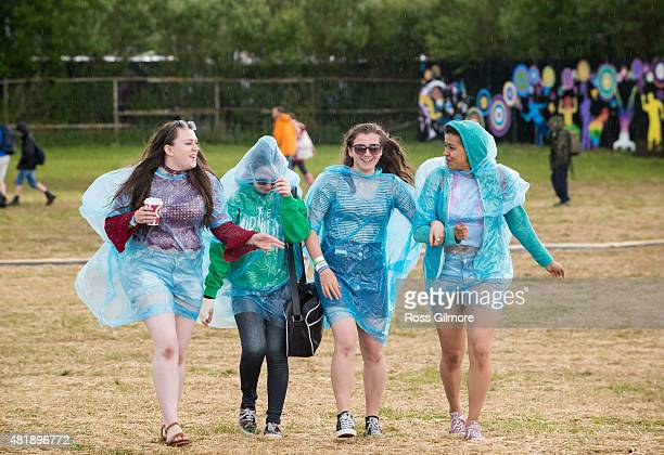 Festival goers wearing plastic ponchos during the Wickerman Festival at Dundrennan on July 25, 2015 in Dumfries, Scotland.