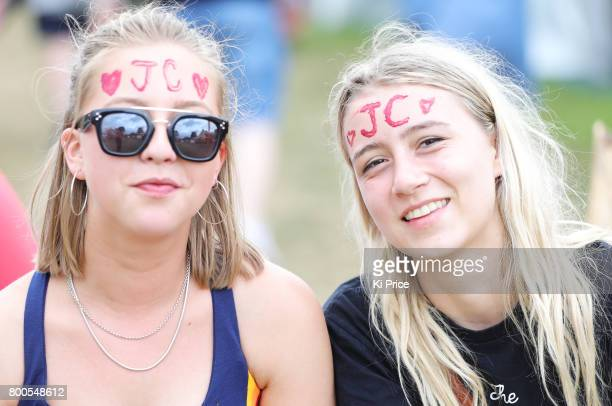 Festival goers with Jeremy Corbyn's initials on their head attend day 3 of the Glastonbury Festival 2017 at Worthy Farm Pilton on June 24 2017 in...