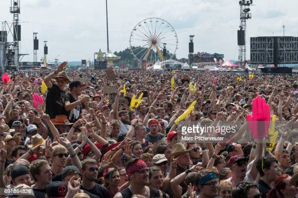 Festival guests enjoy the atmosphere in front of the Volcano Stage during the second day of 'Rock am Ring' on June 3 2017 in Nuerburg Germany
