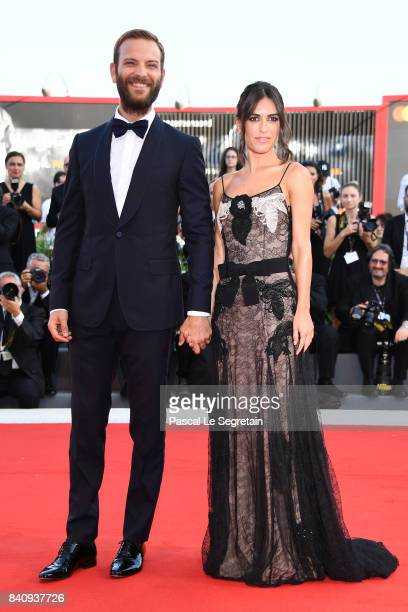 Festival host Alessandro Borghi and Roberta Pitrone walks the red carpet ahead of the 'Downsizing' screening and Opening Ceremony during the 74th...