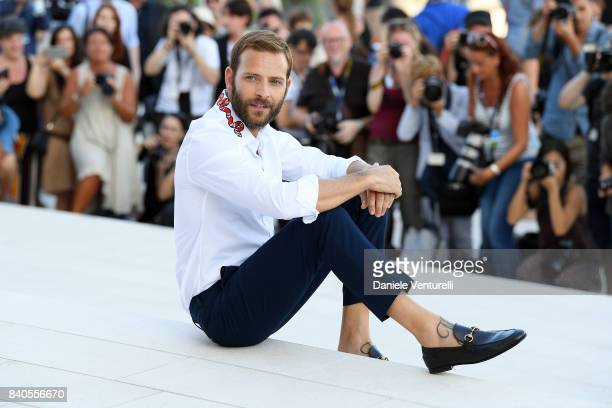 Festival host Alessandro Borghi poses in front of the Palazzo Del Casino during the 74th Venice Film Festival at on August 29 2017 in Venice Italy