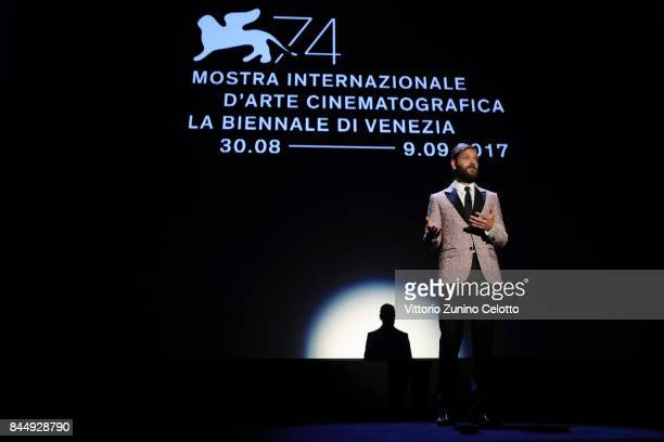 Festival host Alessandro Borghi speaks on the stage during the Award Ceremony of the 74th Venice Film Festival at Sala Grande on September 9 2017 in...