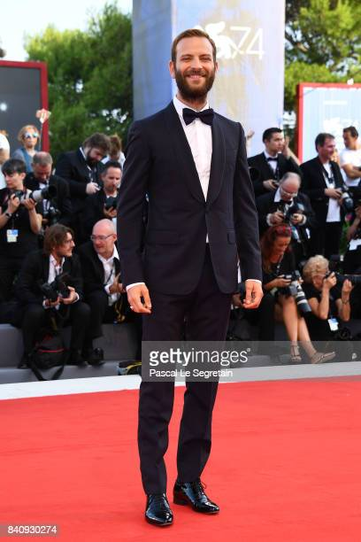 Festival host Alessandro Borghi walks the red carpet ahead of the 'Downsizing' screening and Opening Ceremony during the 74th Venice Film Festival at...