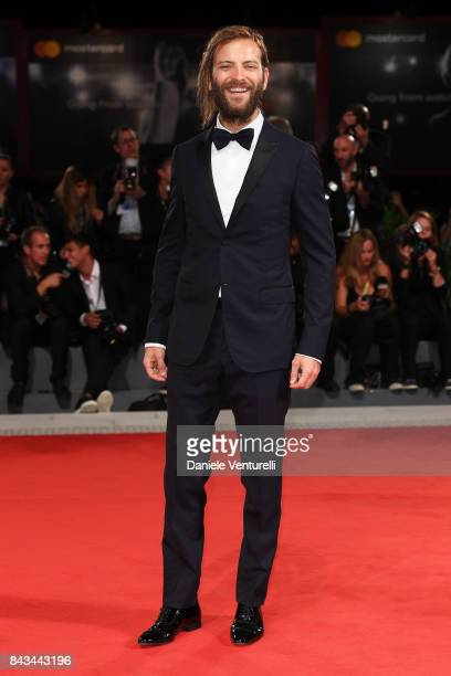 Festival host Alessandro Borghi walks the red carpet ahead of the 'Loving Pablo' screening during the 74th Venice Film Festival at Sala Grande on...