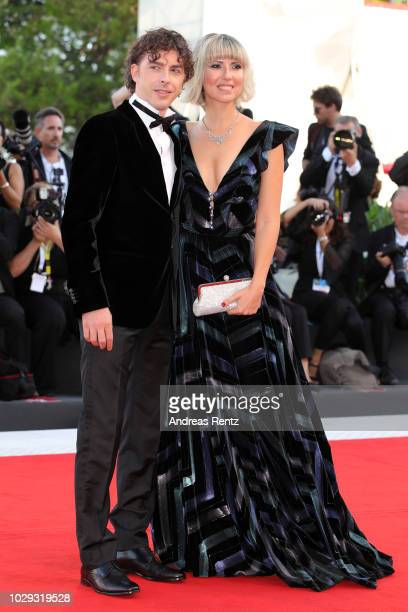 Festival Host Michele Riondino and Eva Nestori walk the red carpet ahead of the Award Ceremony during the 75th Venice Film Festival at Sala Grande on...