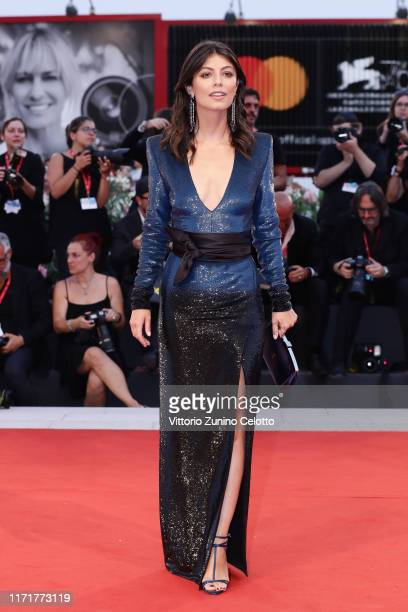 "Festival hostess Alessandra Mastronardi walks the red carpet ahead of the ""Martin Eden"" screening during the 76th Venice Film Festival at Sala Grande..."