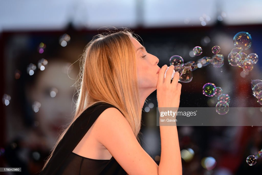 Festival hostess Eva Riccobono a guest of Jaeger-LeCoultre creates soap bubbles on the red carpet for the 'Emergency' charity at the 'Tracks' premiere during the 70th Venice Film Festival at the Palazzo del Cinema on August 29, 2013 in Venice, Italy.