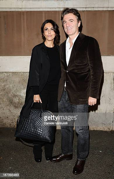 Festival Hostess Sabrina Ferilli and Flavio Cattaneo poses during The 8th Rome Film Festival on November 8, 2013 in Rome, Italy.