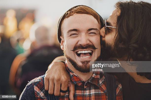 festival kisses - close to stock pictures, royalty-free photos & images