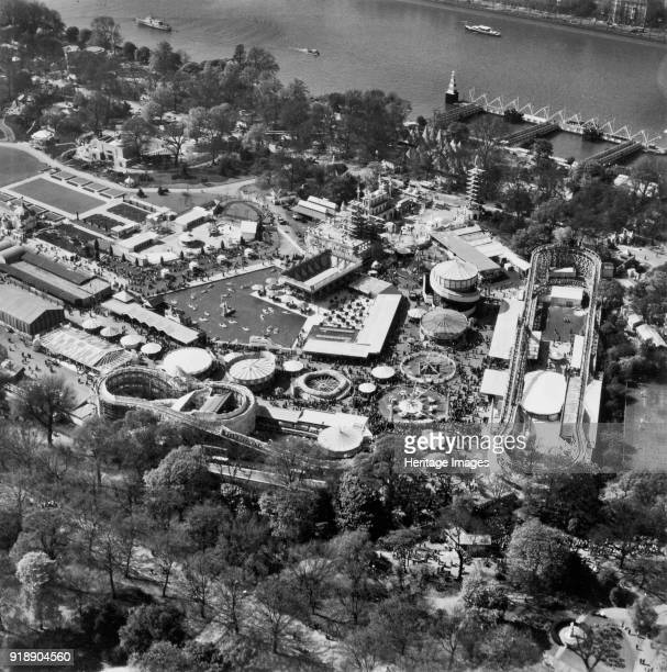 Festival of Britain pleasure gardens Battersea Park London May 1951 View showing the funfair and crowds Artist Unknown