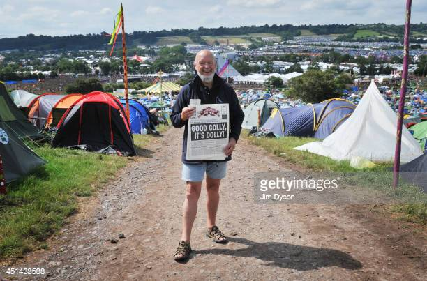 Festival organiser Michael Eavis poses with a copy of the Glastonbury Free Press during day three of the Glastonbury Festival at Worthy Farm in...
