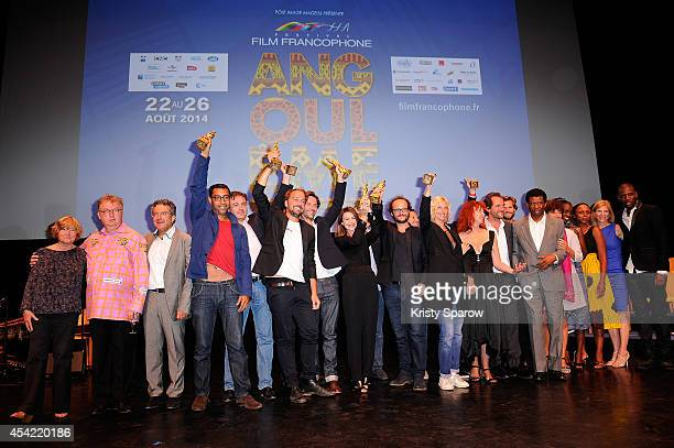 Festival organizers Jury and Winners pose onstage during the 7th Angouleme FrenchSpeaking Film Festival at Theatre d'Angouleme in Angouleme France