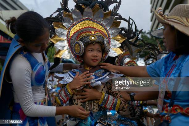 Festival participants dance in the streets as they celebrate the Sinulog festival on January 19 2020 in Cebu Philippines The Sinulog is an annual...