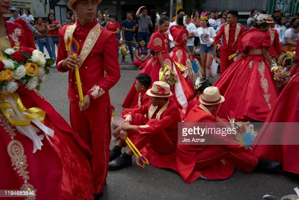 Festival participants take a break as they participate in the celebration of the Sinulog festival on January 19 2020 in Cebu Philippines The Sinulog...