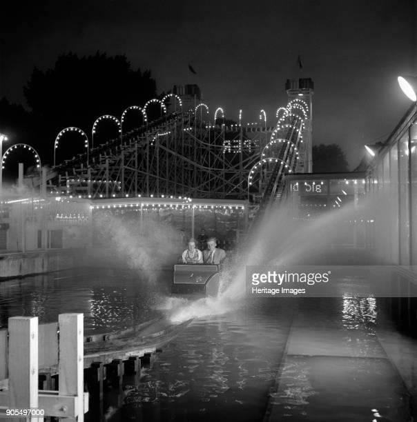 Festival Pleasure Gardens, Battersea Park, Wandsworth, London, 1955-1960. Passengers riding the waterchute fairground ride at the Battersea Festival...