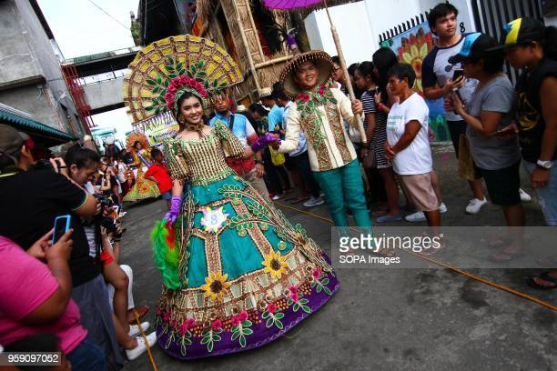 Festival queens join the parade wearing indigenous materials and local produce sourced within the town of Lucban Local and foreign tourists flocked...